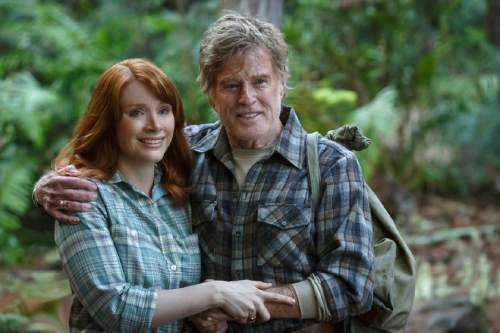 """   Walt Disney Pictures  Grace (Bryce Dallas Howard, left) and her father, Meacham (Robert Redford), see something amazing in the woods, in Disney's """"Pete's Dragon."""""""
