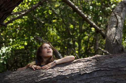 "This image released by Disney shows Oona Laurence in a scene from ""Pete's Dragon."" (Matt Klitscher/Disney via AP)"