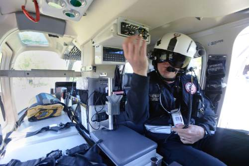 Al Hartmann  photo AirMed flight nurse Brian Simpson gets ready for a helicopter flight from the Calvin Rampton Complex at an event with UHP to promote highway safety Thursday May 26.  Stretcher to his left is where critical care patients ride.