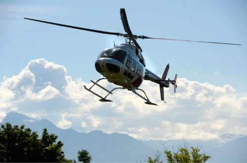 Al Hartmann  photo AirMed helicopter lands at the Calvin Rampton Complex to host an event with UHP to promote highway safety Thursday May 26.