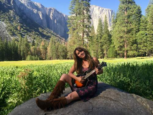 Utah singer-songwriter Gigi Love, pictured in El Cap Meadow in Yosemite National Park, has been writing a song for each national park she visits, with a full album planned for a December release. Courtesy Peter Nicholson