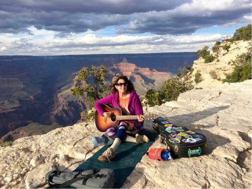 Utah singer-songwriter Gigi Love, pictured at Yavapai Point at the South Rim of Grand Canyon National Park, has been writing a song for each national park she visits, with a full album planned for a December release. Courtesy Peter Nicholson