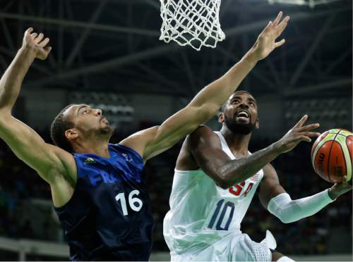 United States' Kyrie Irving (10) drives to the basket past France's Rudy Gobert (16) during a basketball game at the 2016 Summer Olympics in Rio de Janeiro, Brazil, Sunday, Aug. 14, 2016. (AP Photo/Charlie Neibergall)
