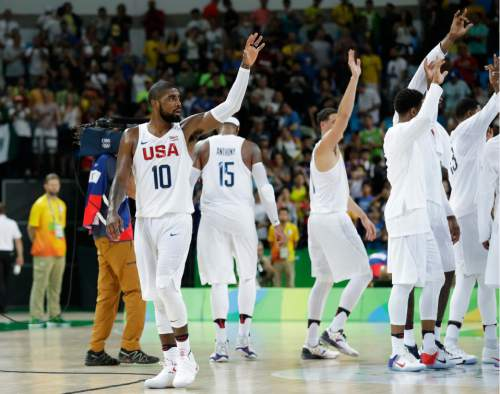 United States' Kyrie Irving (10) celebrates with teammates after a basketball game against France at the 2016 Summer Olympics in Rio de Janeiro, Brazil, Sunday, Aug. 14, 2016. (AP Photo/Charlie Neibergall)