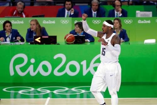 United States' Carmelo Anthony (15) signals to teammates during a men's basketball game against France at the 2016 Summer Olympics in Rio de Janeiro, Brazil, Sunday, Aug. 14, 2016. (AP Photo/Eric Gay)