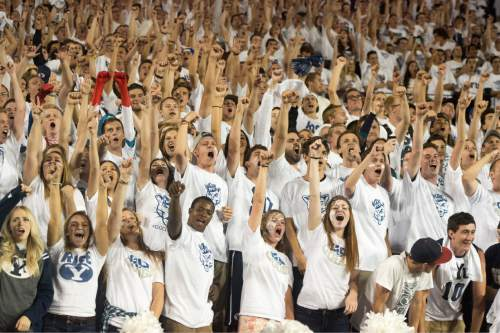 Rick Egan  |  The Salt Lake Tribune  Brigham Young fans celebrate as the Cougars take a 11 point lead with seconds left on the clock, after Kai Nacua's touchdown on an interception, in college football action, BYU vs. Boise State at Lavell Edwards Stadium, Saturday, September 12, 2015.
