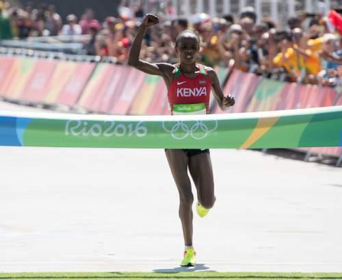 Rick Egan  |  The Salt Lake Tribune  Jemima Jelagat Sumgong crosses the finishline for the gold medal, in the women's Marathon, in Rio de Janeiro Brazil, Sunday, August 14, 2016.