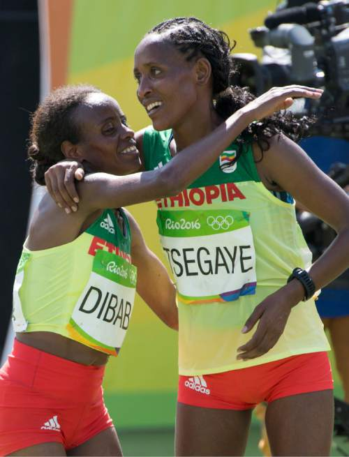 Rick Egan  |  The Salt Lake Tribune   Bronze medalist Mare Dibaba, Ethiopia, hugs Tirfi Tsegaye, who finished forth,  in the women's Marathon, in Rio de Janeiro Brazil, Sunday, August 14, 2016.