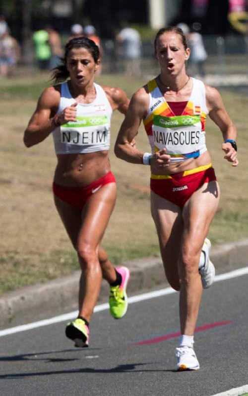 Rick Egan  |  The Salt Lake Tribune  Chirine Njeim, Lebanon, runs alongside Estela Navascues, Spain, in the Women's Marathon, in Rio de Janeiro Brazil, Sunday, August 14, 2016.