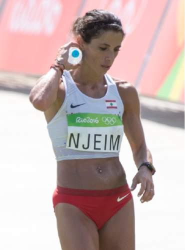 Rick Egan  |  The Salt Lake Tribune  Chirine Njeim, Lebanon, cools down as after crossing the finish line in the Sambódromo, in the Women's Marathon, in Rio de Janeiro Brazil, Sunday, August 14, 2016.
