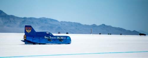 "Chris Detrick  |  The Salt Lake Tribune Danny Thompson races ""Challenger 2"" during Speed Week at the Bonneville Salt Flats Saturday August 13, 2016. Thompson got 411mph on this run."