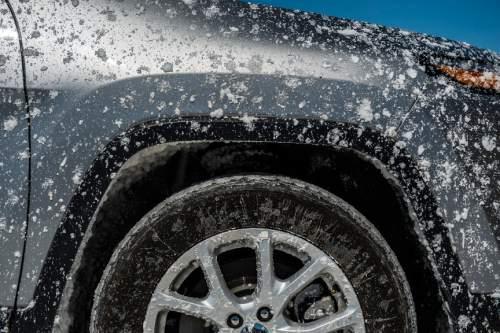 Chris Detrick  |  The Salt Lake Tribune A salt-covered SUV during Speed Week at the Bonneville Salt Flats Saturday August 13, 2016.