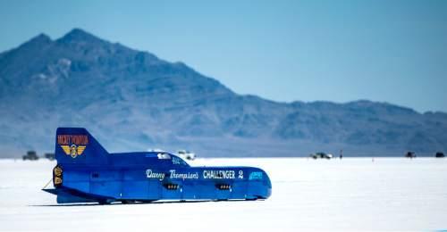 "Chris Detrick  |  The Salt Lake Tribune Danny Thompson races ""Challenger 2"" during Speed Week at the Bonneville Salt Flats on Saturday. Thompson got 411mph on this run."