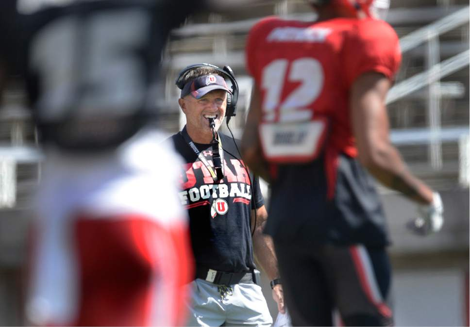 Scott Sommerdorf   |  The Salt Lake Tribune   Utah head coach Kyle Whittingham looks over his players during practice, Thursday, August 11, 2016.