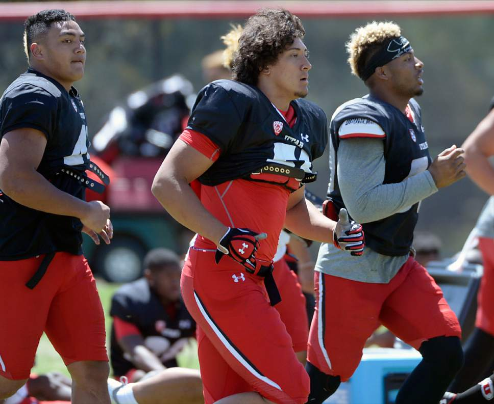 Al Hartmann  |  The Salt Lake Tribune  Bradlee Anae, center, runs wind sprints at the end of practice Tuesday Aug.9.  He is one of three Ute freshmen defensive-linemen with a lot of talent and promise.