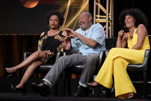 "Jenifer Lewis, from left, Laurence Fishburne and Tracee Ellis Ross participate in the ""Black-ish'"" panel during the Disney/ABC Television Critics Association summer press tour on Thursday, Aug. 4, 2016, in Beverly Hills, Calif. (Photo by Richard Shotwell/Invision/AP)"
