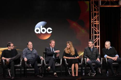 "David Guggenheim, from left, Mark Gordon, Kiefer Sutherland, Natascha McElhone, Simon Kinberg and Jon Harmon Feldman participate in the ""Designated Survivor"" panel during the Disney/ABC Television Critics Association summer press tour on Thursday, Aug. 4, 2016, in Beverly Hills, Calif. (Photo by Richard Shotwell/Invision/AP)"