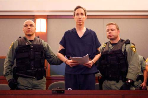 Handcuffed and flanked by Las Vegas Metro PD Swat officers, FLDS leader Warren Jeffs appeared before Judge James M. Bixler in the Clark County Regional Justice Center this morning and waived an extradition hearing, agreeing to be returned to Utah to face charges related to allegedly arranging an underage marriage.  Photo by Trent Nelson; 8.31.2006