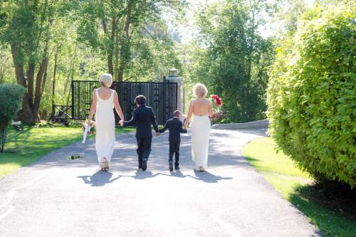 Cat Palmer  |  Courtesy  Salt Lake City Mayor Jackie Biskupski, Betty Iverson along with their sons Archie,11, and Jack, 6 during a private wedding ceremony on August 14, 2016.