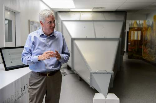 Trent Nelson  |  The Salt Lake Tribune David Hall at his office in Provo, Tuesday June 14, 2016. Nearly 150 scientists and engineers are working for Hall intent on solving technical and social challenges for building a futuristic enclave modeled on Joseph Smith's Plat of the City of Zion. Research focuses on everything from low-impact toilets, new building materials and cooperative economic systems to methods for high-intensity food production. At right is an enclosure for limiting radio interference.
