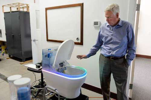 Trent Nelson  |  The Salt Lake Tribune David Hall at his office in Provo, Tuesday June 14, 2016. Nearly 150 scientists and engineers are working for Hall intent on solving technical and social challenges for building a futuristic enclave modeled on Joseph Smith's Plat of the City of Zion. Research focuses on everything from low-impact toilets, new building materials and cooperative economic systems to methods for high-intensity food production. At left is a high tech toilet under development.