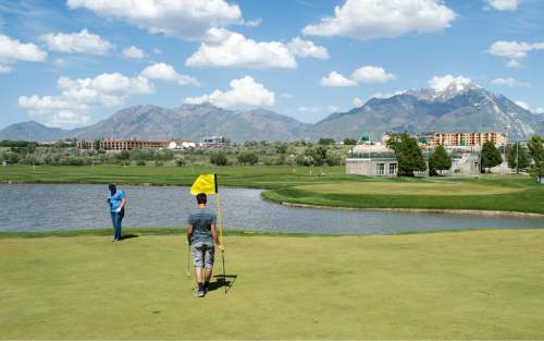 Rick Egan  |  Tribune file photo David Nielson and Bronson Schroeder play golf at Mulligans in 2015.