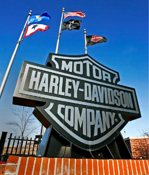 FILE - In this Jan. 18, 2006 file photo, a sign stands outside the corporate offices of Harley Davidson in Milwaukee. Harley-Davidson has agreed to pay $15 million to settle a complaint filed by federal environmental officials over racing tuners that caused its motorcycles to emit higher than allowed levels of air pollution. (AP Photo/Morry Gash, File)