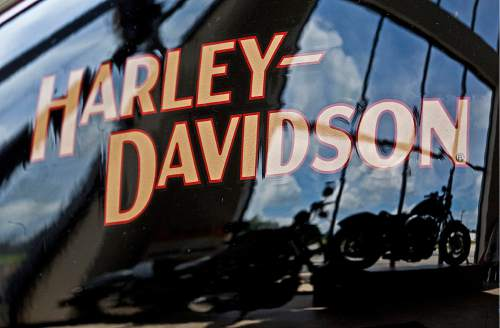 FILE - In this July 20, 2010 file photo, motorcycles are reflected in a gas tank at a Harley Davidson dealer in New Berlin, Wis. Harley-Davidson has agreed to pay $15 million to settle a complaint filed by federal environmental officials over racing tuners that caused its motorcycles to emit higher than allowed levels of air pollution.  (AP/Photo/Morry Gash, File)