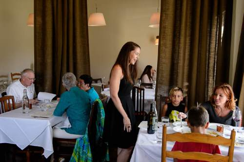 "Trent Nelson  |  The Salt Lake Tribune Co-owner Amy Stevanoni at Veneto, a new fine-dining restaurant in Salt Lake City that has adopted a no-tipping policy. Instead, the Italian restaurant charges a nominal fee or ""coperto"" of $3 per guest ó similar to what is done in Veneto, Italy."