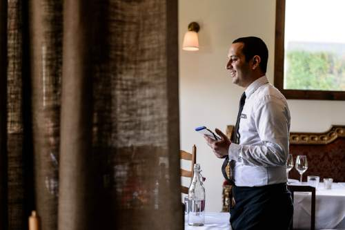 "Trent Nelson  |  The Salt Lake Tribune Ehsan Rahimzadegan serves at Veneto, a new fine-dining restaurant in Salt Lake City that has adopted a no-tipping policy. Instead, the Italian restaurant charges a nominal fee or ""coperto"" of $3 per guest -- similar to what is done in Veneto, Italy."