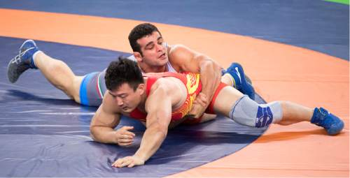 Rick Egan  |  The Salt Lake Tribune  Iranian Ghasem Rezaei defeats China's Di Xiao in men's Greco-Roman 98 kg weight class at Carioca 2 Arena, at the Olympic Games in Rio de Janeiro, Tuesday, August 16, 2016.