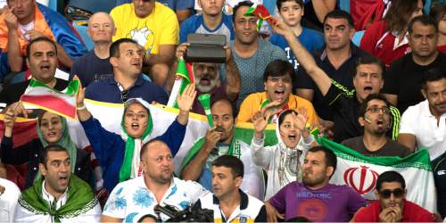 Rick Egan  |  The Salt Lake Tribune  Fans cheer for Iranian wrestler Ghasem Rezaei as he wrestles China's Di Xiao in men's Greco-Roman 98 kg weight class at Carioca 2 Arena, at the Olympic Games in Rio de Janeiro, Tuesday, August 16, 2016.