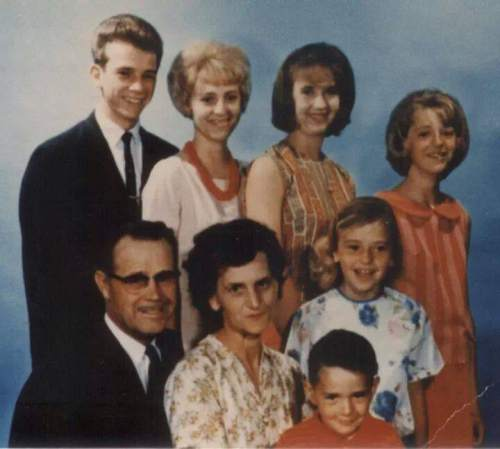 Courtesy  |  Heidi Asay  Loretta Jones, in the back row's center right, poses for a family portrait with her parents and siblings.