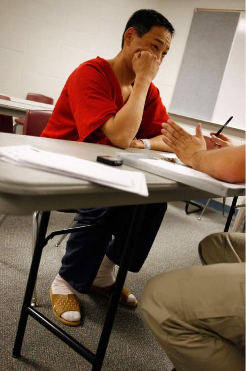 Francisco Kjolseth  |  The Salt Lake Tribune  Jargal Bayar from Mongolia is questioned on March 12, 2008, by Immigration and Customs Enforcement agents who patrolled for undocumented immigrants in Utah County Jail in Spanish Fork in an ongoing process.