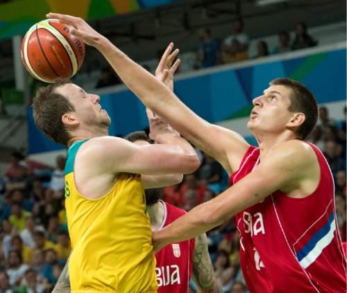 Rick Egan  |  The Salt Lake Tribune  Nikola Jokic (14) of Serbia stops Joe Ingles (7) of Australia, in basketball action, Australia vs. Serbia, at Carioca arena, in Rio de Janeiro, Friday, August 19, 2016.
