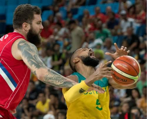 Rick Egan  |  The Salt Lake Tribune  Miroslav Raduljica (13) of Serbia, grabs Patty Mills (5) of Australia, in basketball action, Australia vs. Serbia, at Carioca arena, in Rio de Janeiro, Friday, August 19, 2016.