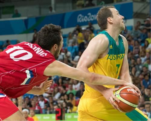 Rick Egan  |  The Salt Lake Tribune  Nikola Kalinic (10) of Serbia grabs the ball, as Joe Ingles (7) of Australia, goes to the hoop, in basketball action, Australia vs. Serbia, at Carioca arena, in Rio de Janeiro, Friday, August 19, 2016.