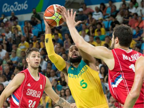 Rick Egan  |  The Salt Lake Tribune  Patty Mills (5) of Australia, tries to get the ball past Stefan Jovic (24) of Serbia add ss10/basketball action, Australia vs. Serbia, at Carioca arena, in Rio de Janeiro, Friday, August 19, 2016.