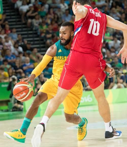 Rick Egan  |  The Salt Lake Tribune  Patty Mills (5) of Australia, tries to get the ball past Nikola Kalinic (10) of Serbia,  in basketball action, Australia vs. Serbia, at Carioca arena, in Rio de Janeiro, Friday, August 19, 2016.