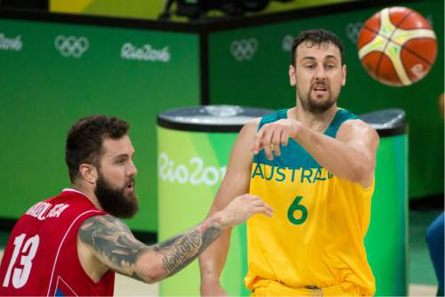 Rick Egan  |  The Salt Lake Tribune  Andrew Bogut (6) of Australia tosses a pass, as Miroslav Raduljica (13) of Serbia defends, in basketball action, Australia vs. Serbia, at Carioca arena, in Rio de Janeiro, Friday, August 19, 2016.