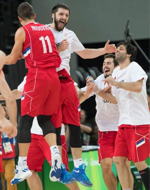 Rick Egan  |  The Salt Lake Tribune  Serbia celebrates their trouncing of Australia, in basketball action, Australia vs. Serbia, at Carioca arena, in Rio de Janeiro, Friday, August 19, 2016.
