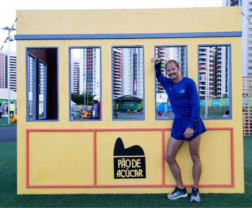Rick Egan  |  The Salt Lake Tribune  Former BYU runner Jared Ward poses by one of the back drops in the Olympic Village, in Rio de Janeiro Brazil, Friday, August 12, 2016.