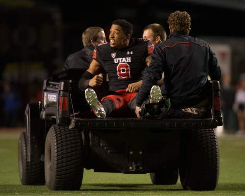 Rick Egan     The Salt Lake Tribune  Utah Utes wide receiver Tim Patrick (9) tries to rally his team as he is taken off the field, after being injured in the 3rd quarter, in PAC-12 action, Utah vs. Oregon game, at Rice-Eccles Stadium, Saturday, November 8, 2014