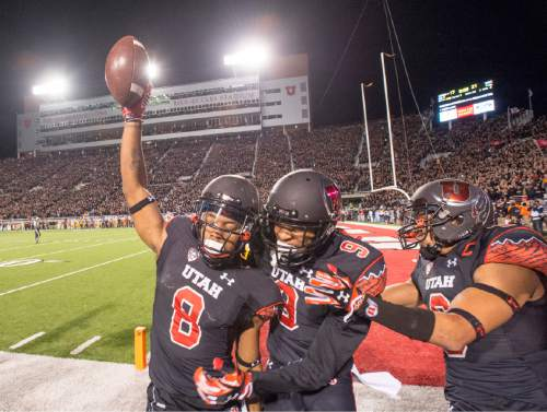 Rick Egan     The Salt Lake Tribune   Utah Utes wide receiver Kaelin Clay (8) celebrates with wide receiver Tim Patrick (9) after scoring the game-winning touchdown, with 8 seconds left in the game, giving the Utes a 24-21 victory of the USC Trojans in Pac-12 action at Rice-Eccles Stadium, Saturday, October 25, 2014.