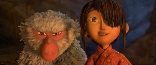 """This image released by Focus Features shows characters Kubo, voiced by Art Parkinson, right, and Monkey, voiced by Charlize Theron in a scene from the animated film, """"Kubo and the Two Strings."""" (Laika Studios/Focus Features via AP)"""