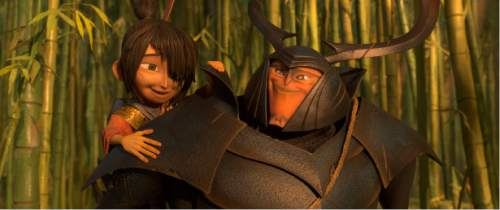 """This image released by Focus Features shows characters Beetle, voiced by Matthew McConnaghey, right, and Kubo, voiced by Art Parkinson in a scene from the animated film, """"Kubo and the Two Strings."""" (Laika Studios/Focus Features via AP)"""