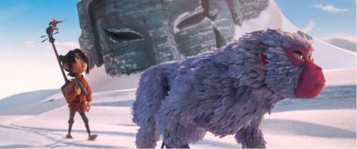 """This image released by Focus Features shows characters Kubo, voiced by Art Parkinson, left, and Monkey, voiced by Charlize Theron in a scene from the animated film, """"Kubo and the Two Strings."""" (Laika Studios/Focus Features via AP)"""