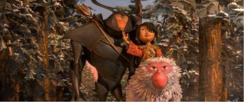 """This image released by Focus Features shows characters Beetle, voiced by Matthew McConnaghey, Kubo, voiced by Art Parkinson and Monkey, voiced by Charlize Theron in a scene from the animated film, """"Kubo and the Two Strings."""" (Laika Studios/Focus Features via AP)"""