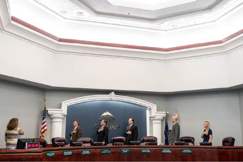 Trent Nelson  |  The Salt Lake Tribune The West Jordan city council stands for the Pledge of Allegiance at the start of their meeting, Wednesday August 10, 2016. From left, City Clerk Melanie Briggs, Dick Burton, Mayor Kim Rolfe, Chad Nichols, Zach Jacob, Sophie Rice.