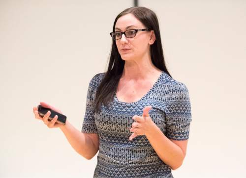 Rick Egan  |  The Salt Lake Tribune  Andrea Hood, Utah Department of Health, speaks Monday, July 25, 2016,  at the Pleasant Valley Library during a volunteer training event to help LGBT Mormons who are contemplating suicide.